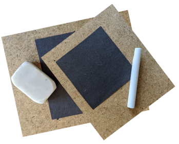 Photo of dark paper, a stick of chalk on one and an eraser on the other.